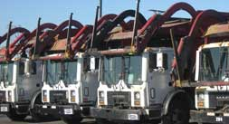A row of parked Front-End Loaders